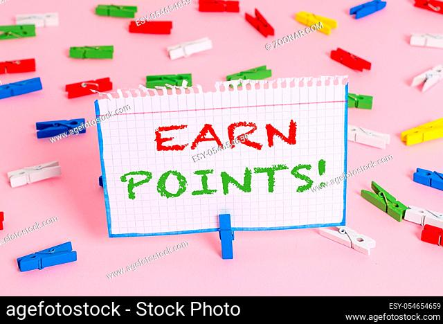 Writing note showing Earn Points. Business concept for collecting scores in order qualify to win big prize