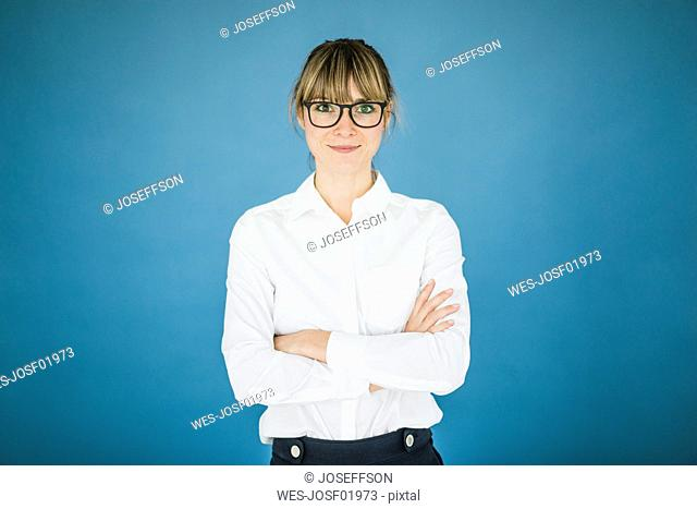 Portrait of smiling businesswoman with glasses