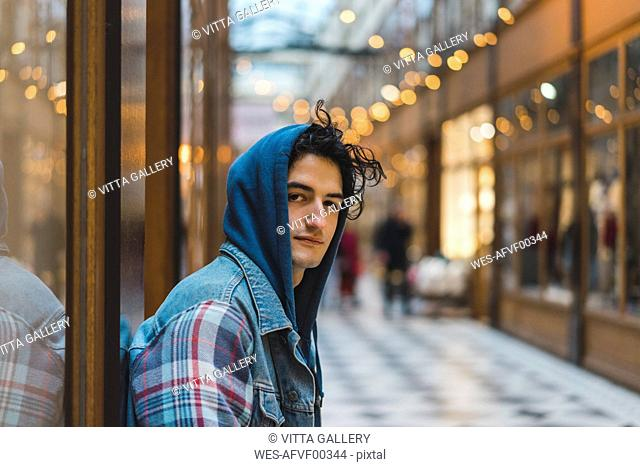 Portrait of young man in shopping centre