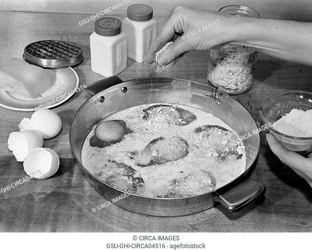 Woman Sprinkling Grated Cheese while Making Baked Eggs with Cheese, A Meat Substitute, Ann Rosener for Office of War Information, October 1942