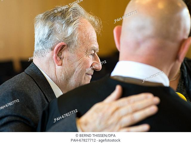 Hungarian witness Imre Lebovits (L)gives an interview with his lawyer Donat Ebert following the trial of Reinhold Hanning in Detmold, Germany, 28 April 2016
