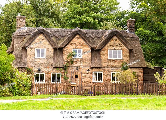 A pretty thatched Cotswold cottage in Frampton-on-Severn , Gloucestershire , England , Britain , Uk