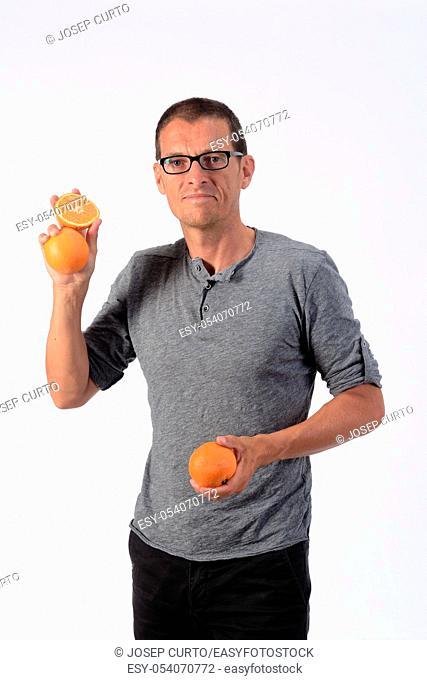 man with orange fruit on white background