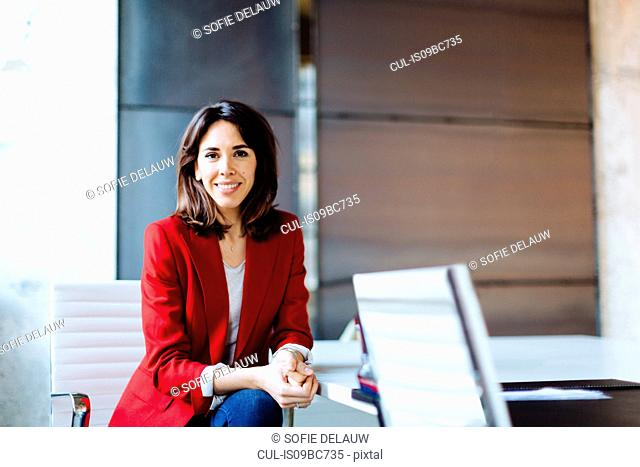 Portrait of businesswoman in office, smiling