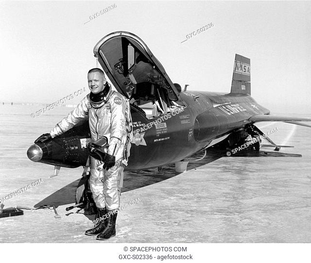 Dryden pilot Neil Armstrong is seen here next to the X-15 ship 1 56-6670 after a research flight. The X-15 was a rocket-powered aircraft 50 feet long with a...