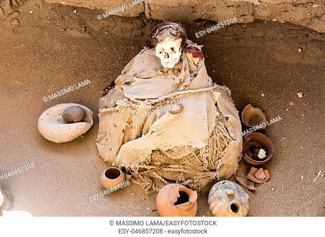 Bones in open inca cemetery in Nazca region , Peru
