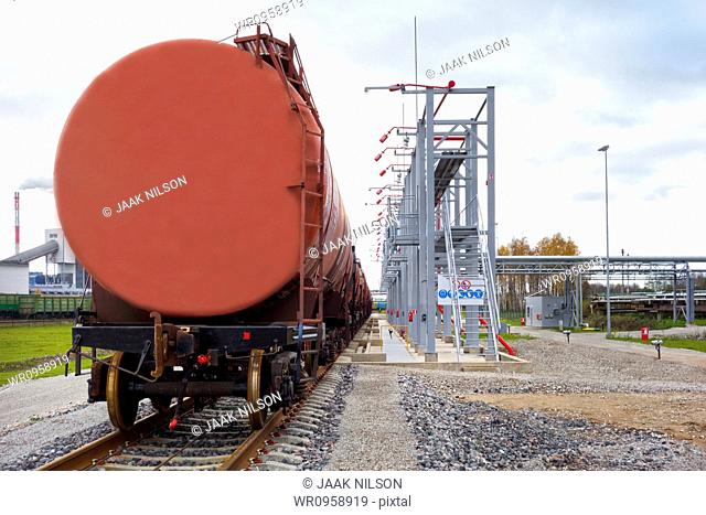A shale oil storage facility, with storage tanks and railway wagons to transport the product of the oil extraction from rock