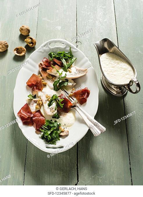 Steamed perch fillets with Bündnerfleisch (dried meat) and a crème fraiche sauce
