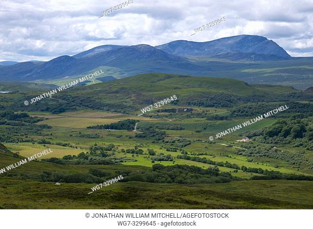 NEAR TONGUE, SCOTLAND, UK - July 19, 2018: A view across the glen to Ben Hope near Tongue in the Scottish Highlands of Sutherland Scotland UK