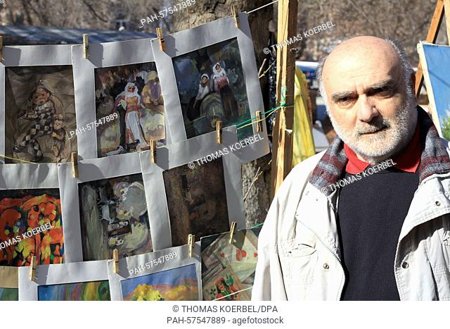 The painter Alexander Owsepjan at his booth in a souvenir market in Yerevan, Armenia, 14 March 2015. On 24 April 2015 the Armenians will observe the 100th...
