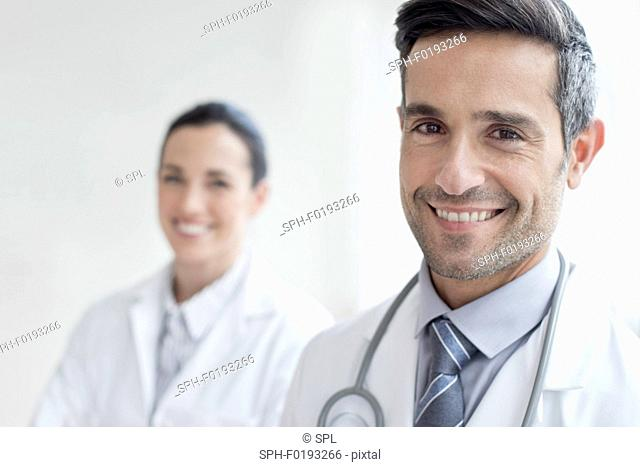 Male doctor with female colleague