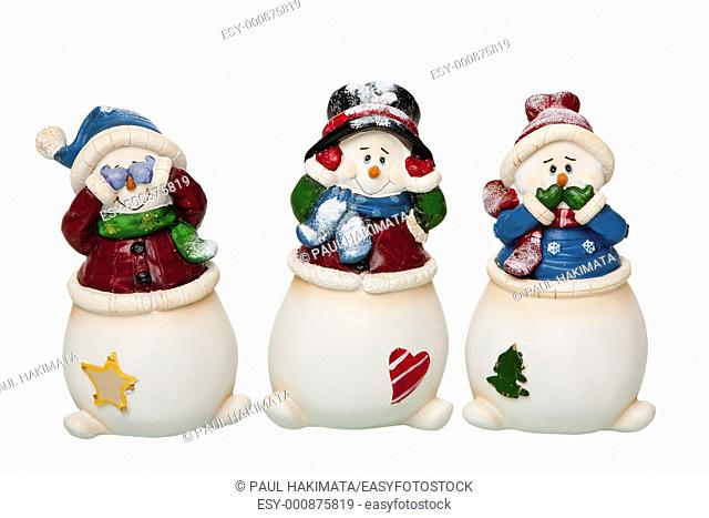Happy smiling Christmas white Snowmen dressed with scarves and hats, see, hear and speak no Evil, covering eyes, ears and mouth, isolated