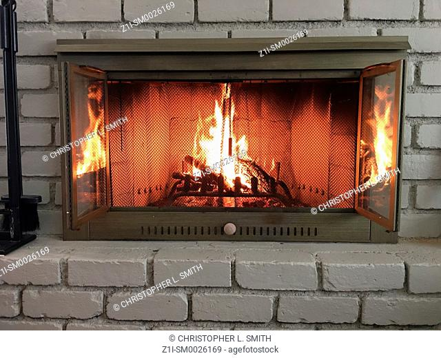 Logs burning in a fireplace on a cold winter's day