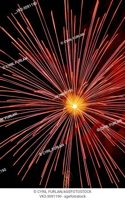 Exploding red sky rocket July 4 celebration