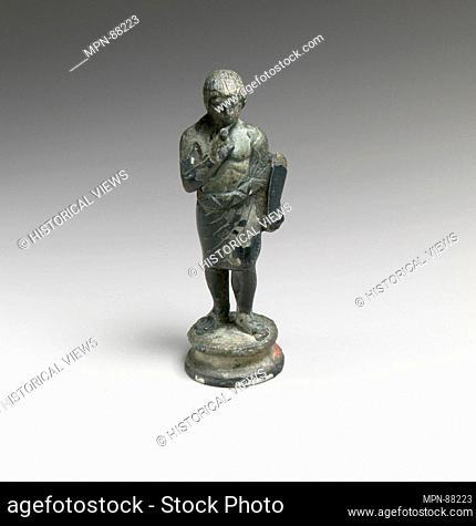 Bronze statuette of a youth. Period: Classical; Date: 5th century B.C; Culture: Etruscan; Medium: Bronze; Dimensions: H.: 3 13/16 in. (9