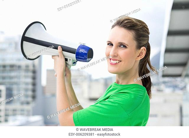 Smiling woman holding megaphone