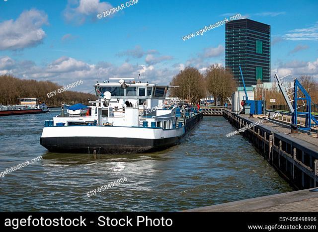 Dutch Amsterdam-Rijn canal with ship mooring at oil transit point near Utrecht
