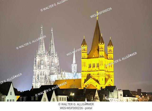 Germany, North Rhine-Westphalia, Cologne, view to lighted Cologne Cathedral and Great St Martin by night