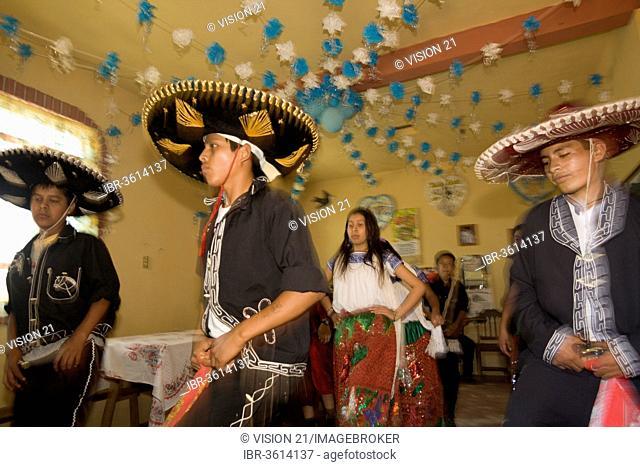 Village festival, dancers in the house of a new Mayordomo, San Miguel, Cuetzalan, Puebla, Mexico