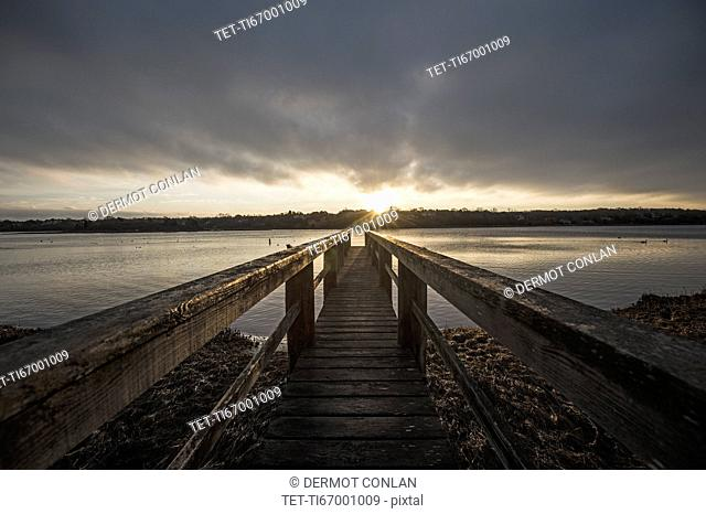 USA, Massachusetts, Eastham, Cape Cod, View from jetty on lake at sunrise