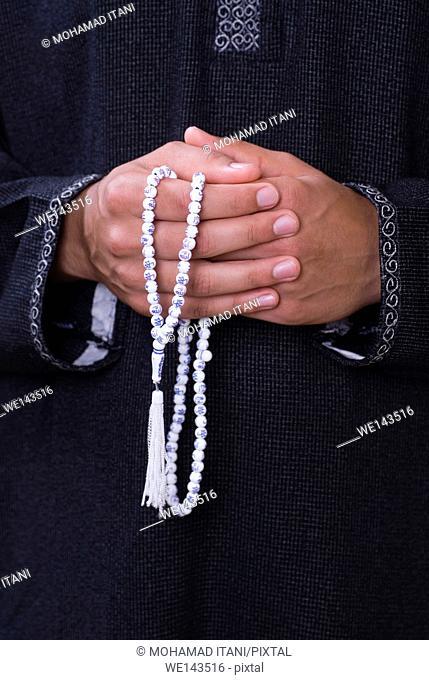 Man holding praying beads