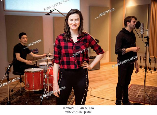 Beautiful woman smiling in recording studio