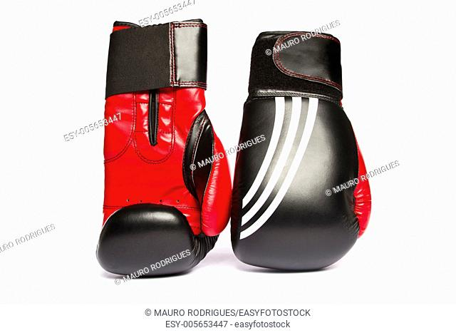 Close view of some red boxing gloves isolated on a white background