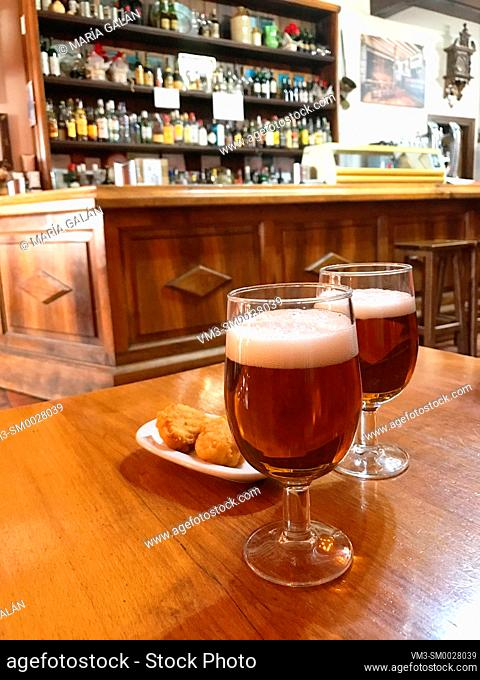 Two glasses of beer in a traditional tavern. Pedraza, Segovia province, Castilla Leon, Spain