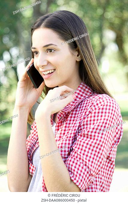 Woman receiving phone call with good news