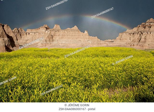 Rainbow over buttes in Badlands National Park, South Dakota, USA