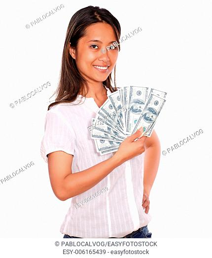Portrait of a smiling asiatic young woman with cash money looking at you on isolated background