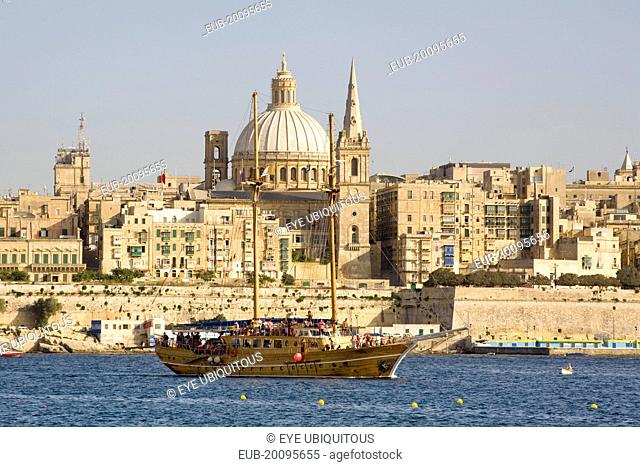 View of the capital city of Valletta from Sliema, and large yacht in foreground