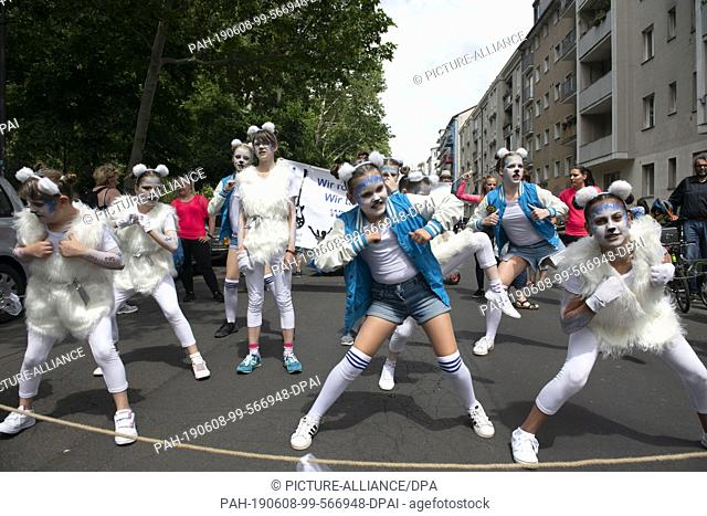 """08 June 2019, Berlin: Girls from the project """"""""BAFF"""""""" from Joachimsthal show a dance during the children's parade at the Carnival of Cultures"""