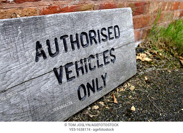 Wooden authorised vehicles only sign on driveway, England, UK