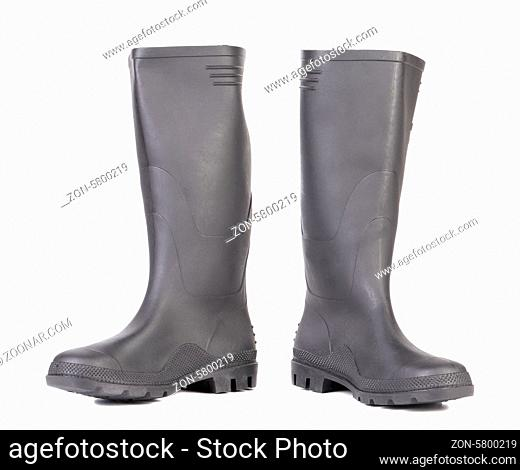 High rubber boots black color. Isolated on a white background