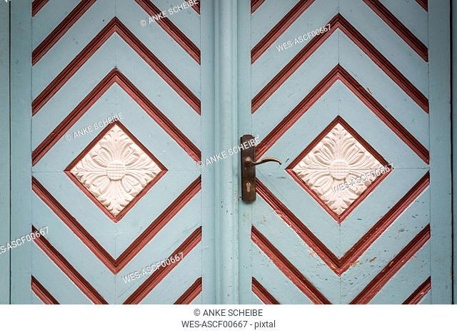Ornamented entrance door, partial view
