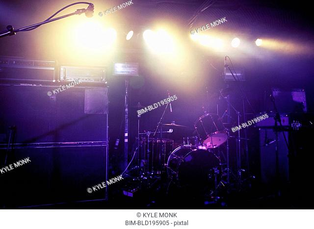 Drum kit on spotlighted stage