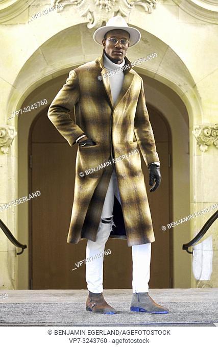 stylish man wearing winter coat in city, full body shot, men's trend outfit, in Munich, Germany