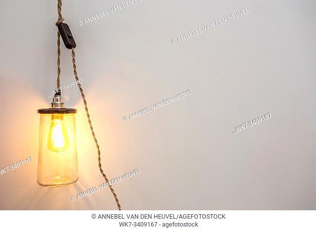 Beautiful retro luxury interior bulb lighting lamp decor glowing in a modern home background texture modern design