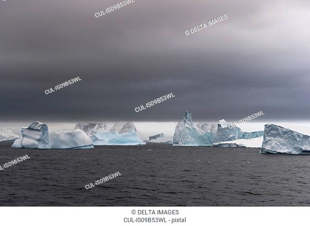 Icebergs under a stormy sky, Lemaire channel, Antarctica
