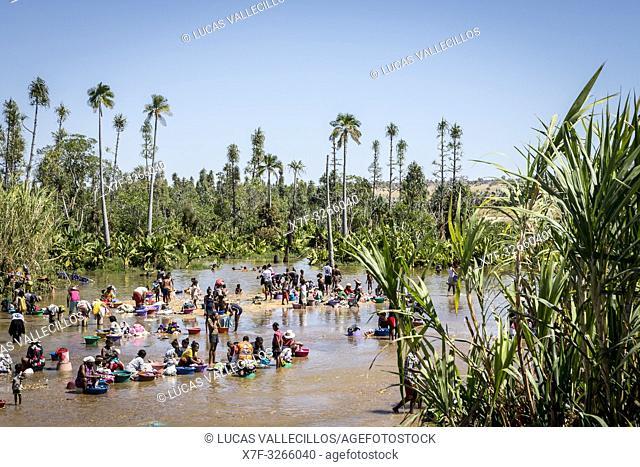 People washing clothes in the river of Ilakaka village, Madagascar
