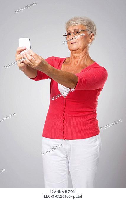 Senior woman has problems with eyesight. Debica, Poland