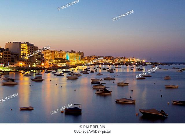 Boats on water at dusk, Qawra, Malta