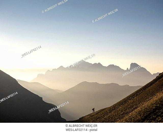 Italy, Lombardy, Bergamasque Alps, hiker on the way to Passo del Gatto, Cima Bagozza and Mount Camino