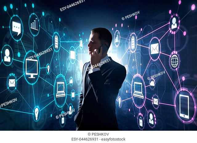 Businessman talking on the phone on abstract blurry background with digital interface. Future and communication concept. Double exposure