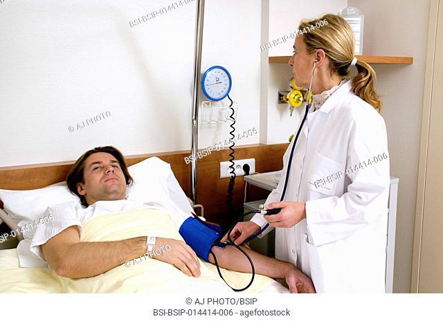 A nurse takes a patient's blood pressure