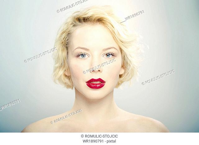 Young woman, red lips, portrait