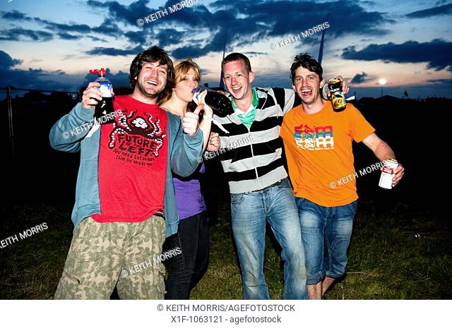 Four young people drinking and enjoying the music at The Square Festival, Borth, July 2009  Wales UK