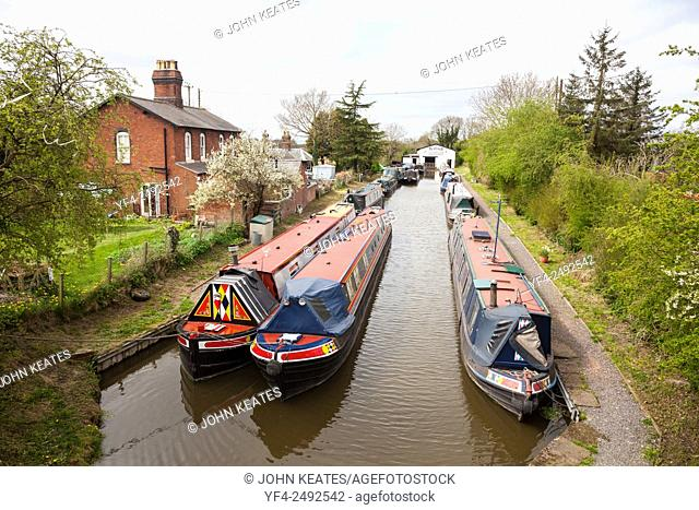 Narrow boats or barges at Norbury Junction on the Shropshire Union Canal Norbury near to Stafford Staffordshire England UK