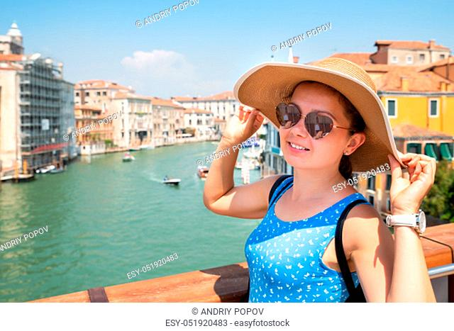 Portrait Of Smiling Young Woman Wearing Hat Posing In Front Of Venice Grand Canal